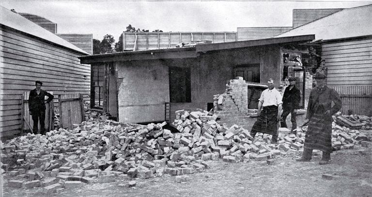 Some of the destruction by earthquake at Cheviot, North Canterbury, 16 Nov. 1901 : back of McTaggart's butcher/baker shop. [17 Nov. 1901]