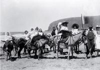 Children taking donkey rides on Sumner beach, Christchurch