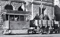 A Kitson steam tram runs past the Government Buildings in Cathedral Square with tramways workers on board [1927]