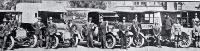 Some members of the St John Ambulance Brigade with the vehicles used as ambulances during the influenza epidemic