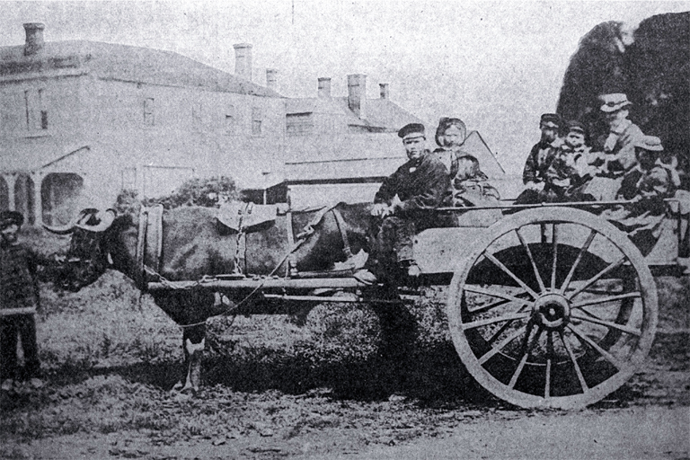 The Stanley family in their bullock cart in Cathedral Square, Christchurch