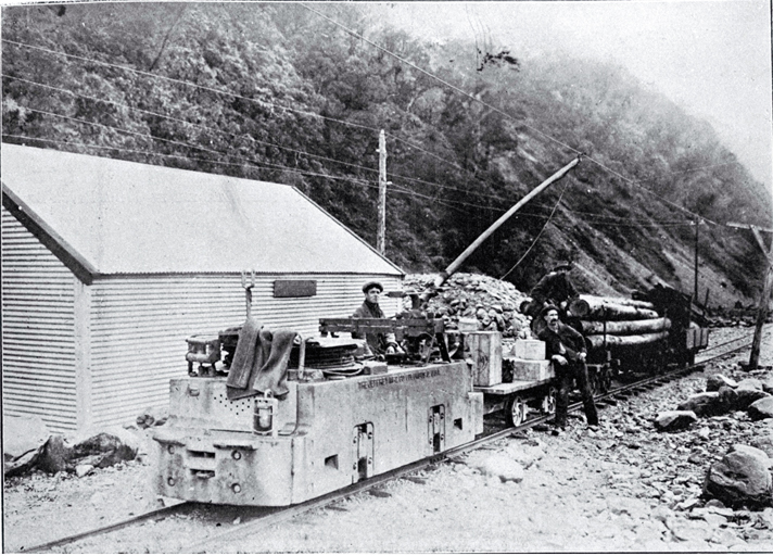 Electric locomotion with a train load of explosives and timber to be used in the construction of the Arthur's Pass Tunnel