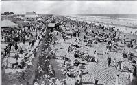 A crowded New Brighton beach, New Zealand, on gala day