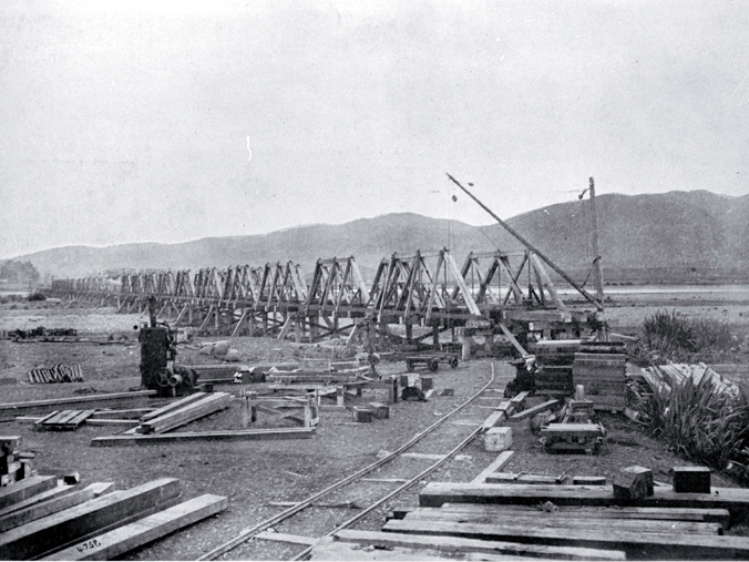 The south end of the combined road and rail bridge under construction over the Waiau River