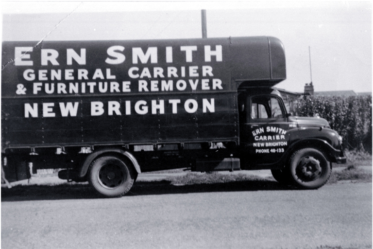 A truck belonging to Ern Smith, general carrier and furniture remover, New Brighton