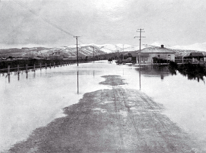 Extensive flooding on 17 April 1925 in Barrington Street, looking south from Howard Street, Christchurch