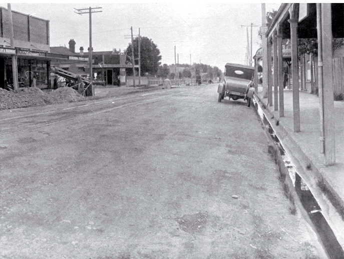 "Barbadoes Street intersection with Edgeware Road, looking north : ""shewing excessive and dangerous crossfall"" [camber]."