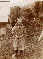 Dorothy Gimblett - August 1907 - at Mcdowell's (10 1/2) Bridle Path Road, Heathcote - note pet magpie.
