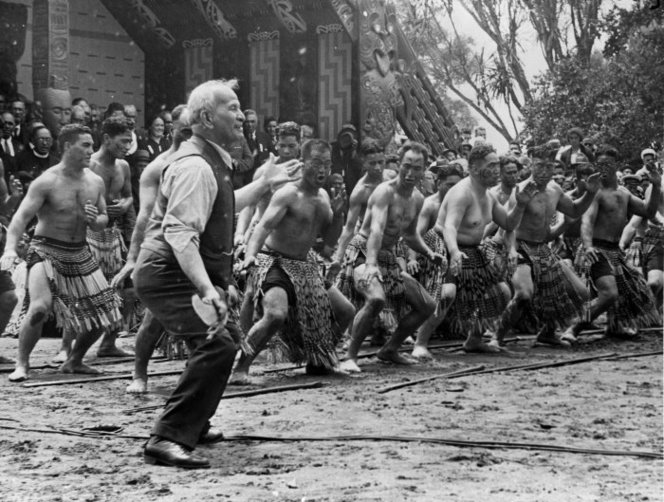 Snowden, James Robert, 1904-1982. Creator unknown : Photograph of Apirana Ngata taking the lead in a haka on Waitangi Day at the centennial celebrations at Waitangi, taken by Bert Snowden. Ref: 1/2-029794-F. Alexander Turnbull Library, Wellington, New Zealand.