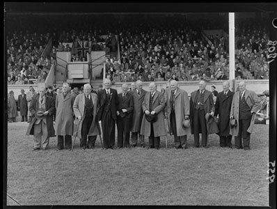 Members of the 1905 All Black rugby union football team gather at Athletic Park, Wellington, 1955.