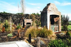 The memorial garden established among the foundations and chimney stack remains of the historic Awhitu House, Taumutu.