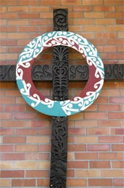 Carved cross on the frontage of Te Rangimārie Centre