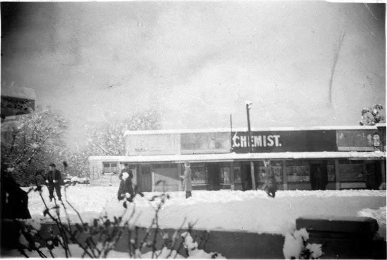 The shops on Normans Road, Bryndwr, shown after a heavy snowfall