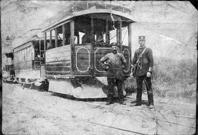 A Kitson steam tram hauling two saloon double-deckers
