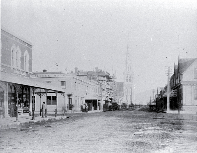 Colombo Street north : on left is Mrs Sharland's corset shop, on corner of Armagh Street is Golden Fleece Hotel.
