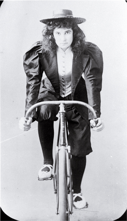 Lady racing cyclist, Lancaster Park, Christchurch