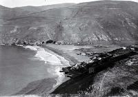 Photo of The beach and holiday baches at Taylor's Mistake [193-?]