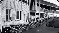 Children lying on stretchers outside the Fresh Air Home, Cashmere Sanatorium, Christchurch