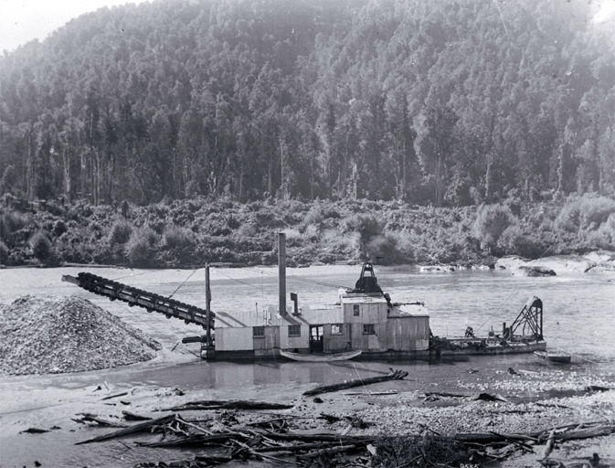 A gold dredge on the Buller River, West Coast