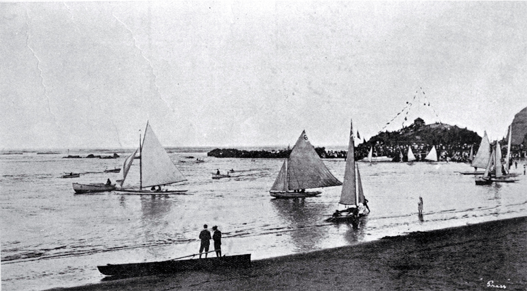 Yachts of the Christchurch Sailing Club fleet under sail near the pier at Cave Rock, Sumner