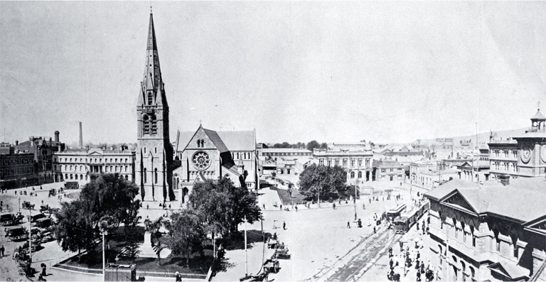 Cathedral Square from the top of the Royal Exchange building showing trams, Post Office and Cathedral, cabs