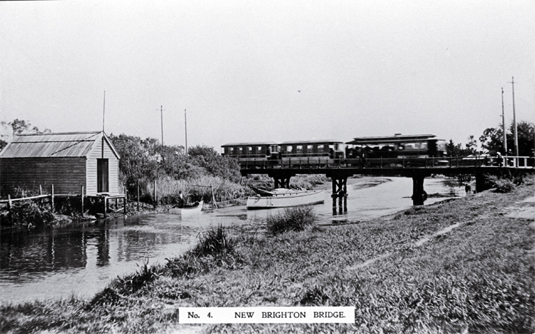 An electric tram crosses the New Brighton bridge with a barge moored underneath [ca. 1910] File Reference CCL PhotoCD 2, IMG0005