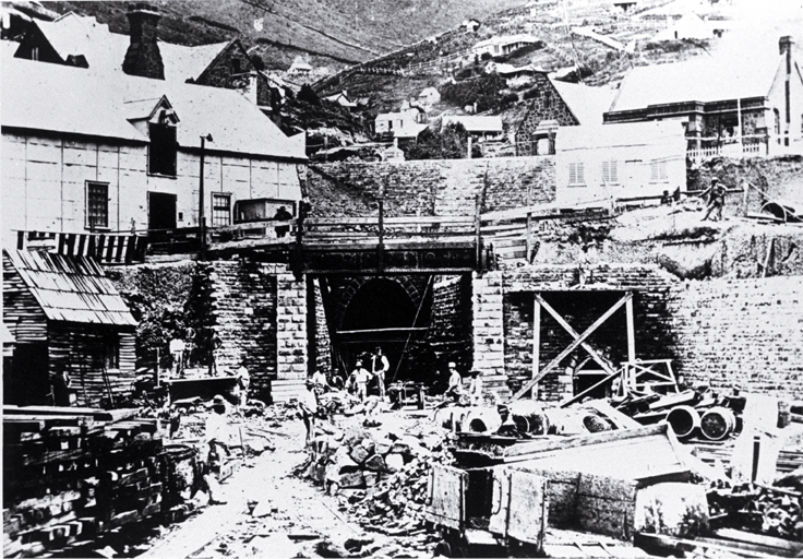 The Lyttelton portal of the Lyttelton Rail Tunnel with construction workers. [1867] CCL PhotoCD 2, IMG0023