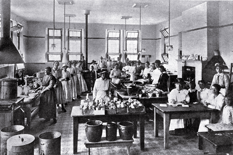 The soup kitchen at the Sydenham Manual Training Centre : some workers under Miss Ponder.