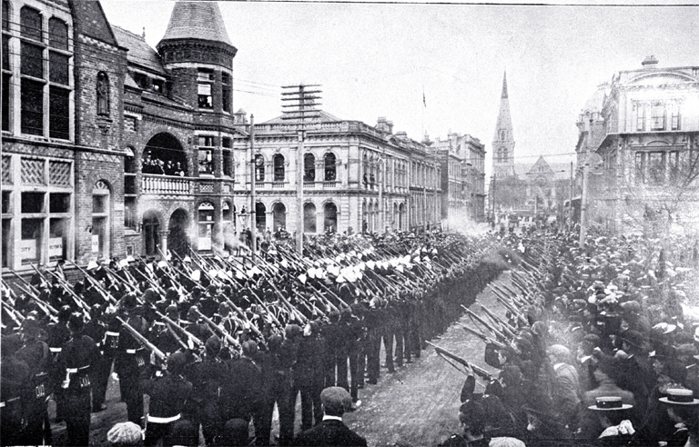 Christchurch volunteers shown firing a feu-de-joie after the Mayor of Christchurch (George Payling) delivered the proclamation of the change of status of New Zealand from a colony to a dominion